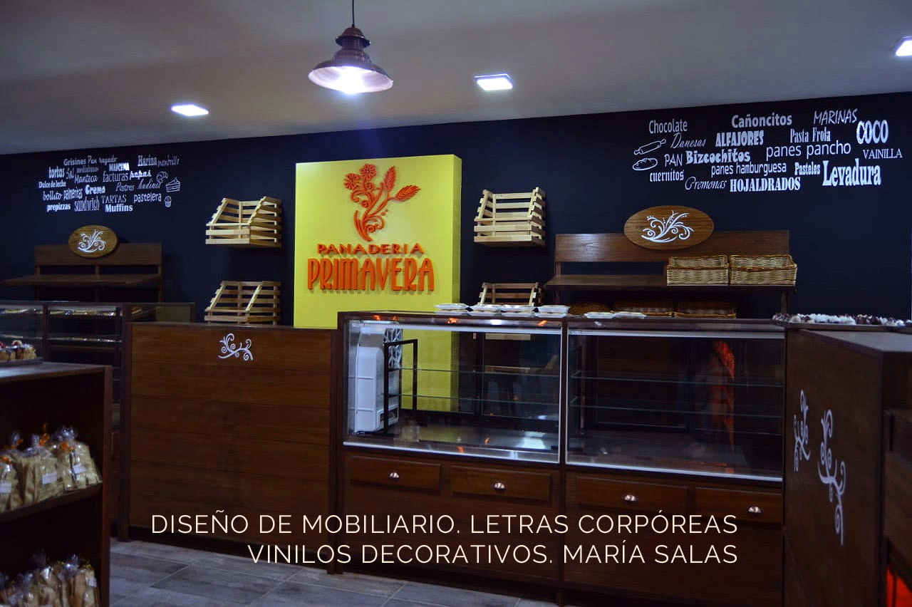 Diseño de mobiliario, letras corpóreas,vinilos decarativos para la panadería Primavera por María Salas, Diseño e interiores