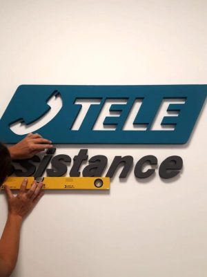 Letra corporea para Tele Assistance, telecomunicaciones por María Salas. D & I